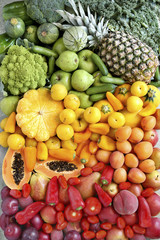 Summer gradient fruit and vegetables on metal background.Top view