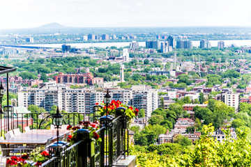 Cityscape or skyline aerial view of downtown Montreal city, Canada from Mont Royal with villa balcony decorated with flowers