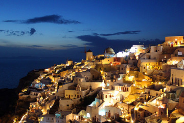 Greek Cityscape of Buildings at Dusk in the town of Oia, Santorini, Greece