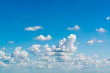 Fantastic white clouds against blue sky
