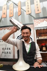 "Kit Cheung, Founder of Spirit of Spirit and Bar Consultant of Sohofama mixes ""Smoking Chamomile"", a Hong Kong inspired cocktail."
