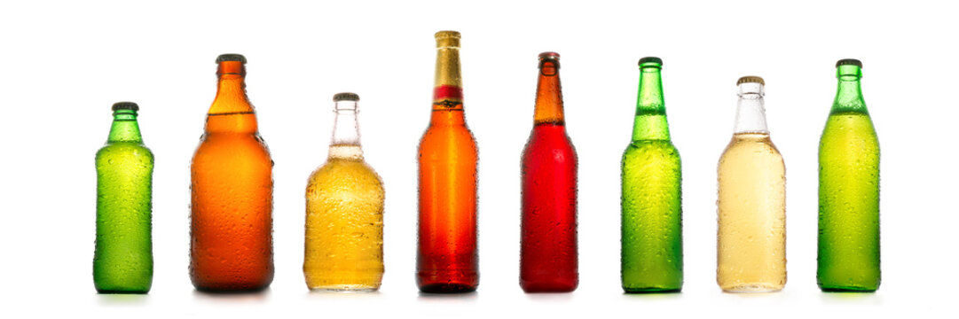 Different beer bottles with water drops collection