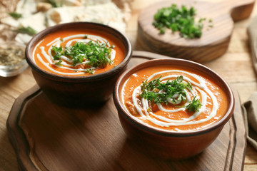 Bowls with delicious Murgh Makhani on table