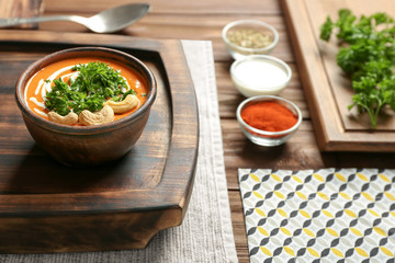 Bowl with delicious Murgh Makhani on table