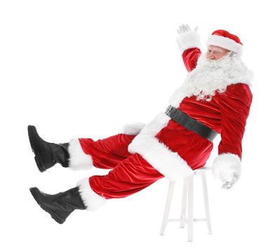 Authentic Santa Claus sitting on chair against white background