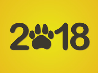 Inscription 2018 with a dogs paw as a symbol of the coming new year. Congratulations on the new year on a yellow background. Vector illustration.