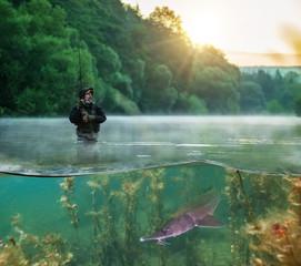 Fisherman trying to catch predator fish, half to half image mantage