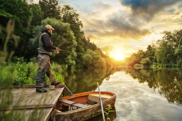 Spoed Fotobehang Vissen Sport fisherman hunting fish. Outdoor fishing in river