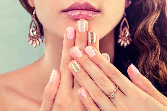 Beautiful woman showing her manicure
