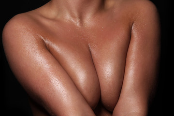 female topless body, naked girl on a black background