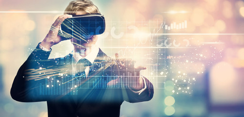 Graphs with businessman using a virtual reality headset