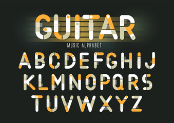 Concept of vector geometric alphabet. Theme of guitar, musical instruments, steam punk.