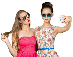Two beautiful girls making selfie