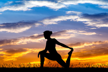 girl doing exercises at sunset