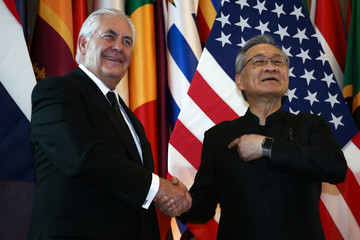 Tillerson shakes hands with Thailand's FM Pramudwinai at the Ministry of Foreign Affairs in Bangkok