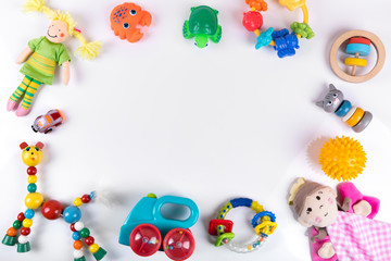 baby toys on white with copy space. top view