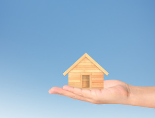 Mortgage concept by house  in hand