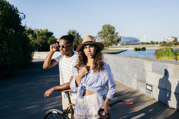 Young couple with bicycle in street