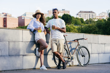 Couple with drinks and bike