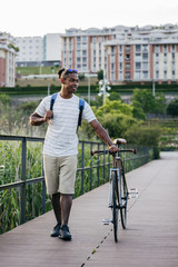 Man walking with bicycle