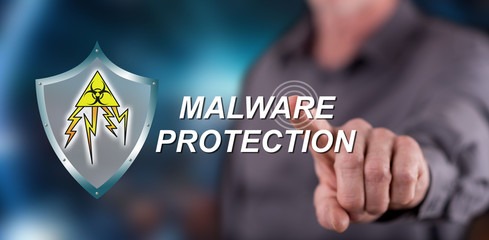 Man touching a malware protection concept on a touch screen
