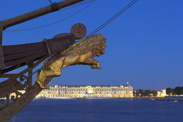 """Sculpture of a lion on the nose of the sailing ship """"Flying Dutchman"""" in a summer night in St. Petersburg, Russia"""