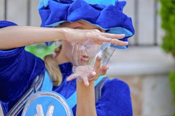 Artist making a big soap bubble