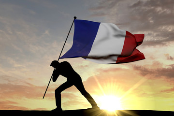 France flag being pushed into the ground by a male silhouette. 3D Rendering