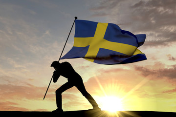 Sweden flag being pushed into the ground by a male silhouette. 3D Rendering