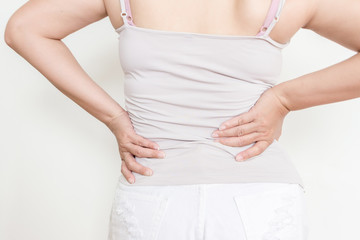 Have pains and aches,Woman with back pain holding