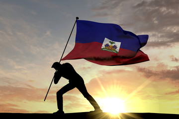 Haiti flag being pushed into the ground by a male silhouette. 3D Rendering