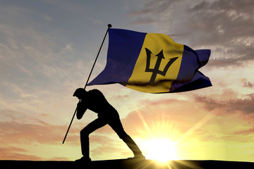 Barbados flag being pushed into the ground by a male silhouette. 3D Rendering
