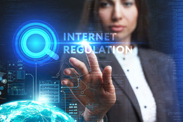 The concept of business, technology, the Internet and the network. A young entrepreneur working on a virtual screen of the future and sees the inscription: Internet regulation