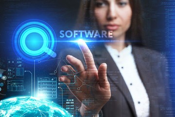 The concept of business, technology, the Internet and the network. A young entrepreneur working on a virtual screen of the future and sees the inscription: Software