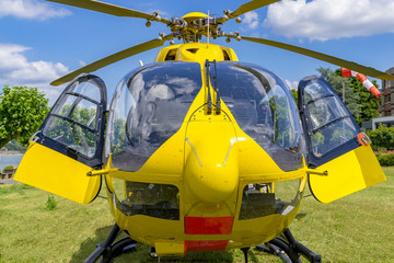 """Andernach, Germany - July 04 2017: Waiting ADAC rescue ambulance helicopterwith name Christoph 75 'Koelsch Maedche""""; Airbus factory; Rhineland-Palatinate"""