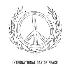 Hand drawn peace symbol and laurel leaves
