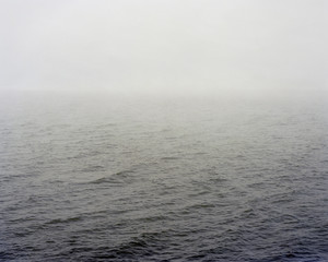 body of water disappearing in the mist