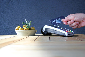 contactless payment card pdq background copy space with hand holding credit card to pay stock, photo, photograph, picture, image,