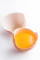 Eggs isolated on white background. Cracked egg shell with yolk