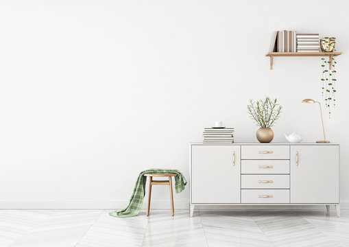 Clean living room interior with chest of drawers, stool, plaid and shelf with books on white wall background. 3D rendering.