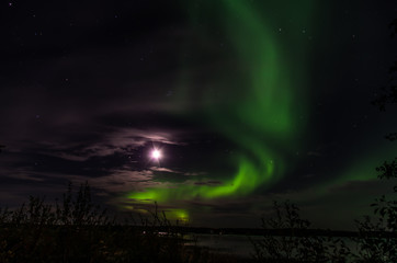 Glowing moon and the northern lights