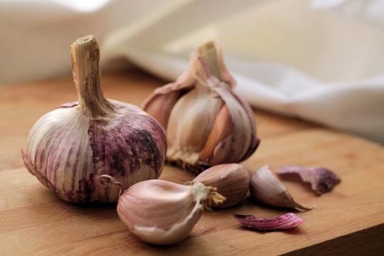 Garlic on wood  chopping board