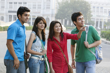 Group of happy college friends looking away