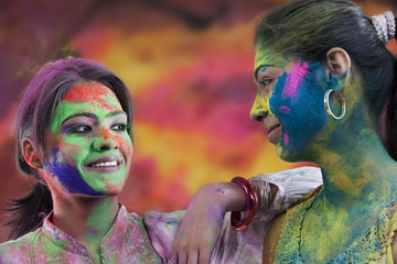 Women covered in holi colours