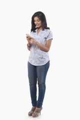 Young woman reading an sms on mobile phone