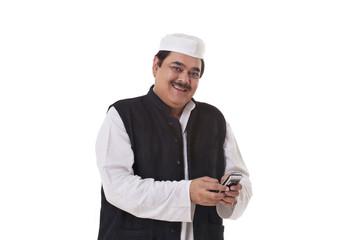 Portrait of happy politician texting