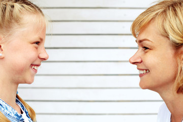 Mother and daughter face to face. Family upbringing