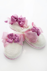 Pair of blank white home slippers and ornate coronet. Bed shoes accessory footwear