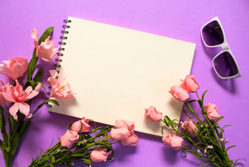 Rose flower frame of blank page on violet background. Romantic pink flower bouquet.