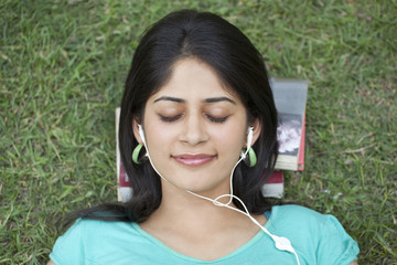 Close-up of woman listening to music